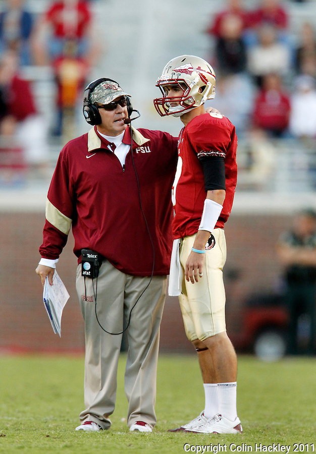 TALLAHASSEE, FL 10/22/11-FSU-MARY102211 CH-Florida State Head Coach Jimbo Fisher talks with quarterback Clint Trickett in the closing moments of the Maryland game Saturday at Doak Campbell Stadium in Tallahassee. The Seminoles beat the Terrapins 41-16..COLIN HACKLEY PHOTO