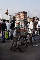 A man takes a bicycle laden with eggs through the streets of Dharavi on 12th Dec 2006.