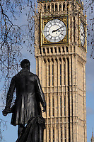 Statue of Henry John Temple, 3rd Viscount Palmerston, 1784-1865, politician, twice Prime Minister, by Thomas Woolner, 1825-92, seen from the back, and Big Ben, 1858, clock tower of Palace of Westminster or Houses of Parliament, 1840-60, London, UK, by Sir Charles Barry and Augustus Pugin. The Gothic Perpendicular building replaced its predecessor, destroyed by fire, 1834. The 96.3 metre high clock tower is named after its largest bell, Big Ben. Picture by Manuel Cohen