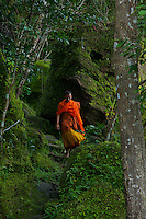 "Monk inside the Bat Cave and temple at Phnom Kulen, ""Elephant Park"" and Bat Caves, Cambodia"