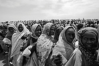 Habila, West Darfur, August 10, 2004.IDP beneficiaries of a WFP food distribution operation waiting for a plane airdrop. More than 140 metric tons of food in 2800 50 Kg bags will be dropped in one day from four big Yliuchin cargo planes. During the month of July 2004 alone, the WFP distributed food for more than 951 000 people in Darfur.