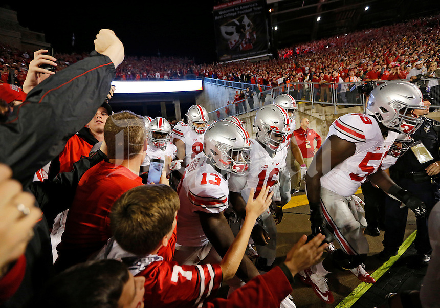 The Ohio State Buckeyes take the field for the NCAA football game against the Wisconsin Badgers at Camp Randall Stadium in Madison, Wisconsin on Oct. 15, 2016. (Adam Cairns / The Columbus Dispatch)