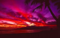 """A sunset like a """"hand of fire"""" over Lana'i, as seen from Launiupoko State Wayside Beach Park just outside of Lahaina, Maui. Per this photographer, the colors danced in the sky like a giant hand with four fingers and a thumb for over 25 minutes after sunset, an uncommonly long time in his experience with Hawaiian sunsets."""
