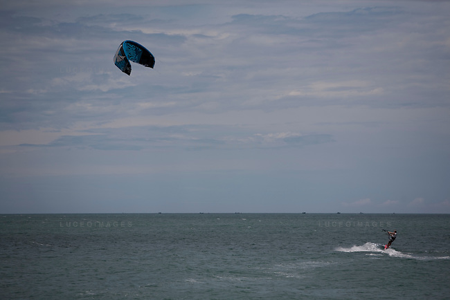 Scott Soothill, owner of STORM Kiteboarding, launches the first kite of the day on Mui Ne beach.  There was only enough wind for the one ride. The wind season usually lasts from November through March.