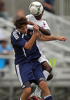 HYATTSVILLE, MD - OCTOBER 26, 2012:  Arion Sobers-Assue (13) of DeMatha Catholic High School clashes in the air with Camyer Matini (5) of St. Albans during a match at Heurich Field in Hyattsville, MD. on October 26. DeMatha won 2-0.