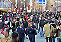 "January 23, 2011, Tokyo, Japan - Police patrol ""Pedestrian Paradise"" in Tokyo's Akihabara district on Sunday, January 23, 2011. A record crowd of about 100,000 shoppers and tourists returned to Japan's electronics capital as the pedestrian-only shopping zone reopened for the first time in two years and seven months after the 2008 stabbing rampage that left seven dead and 10 others injured. (Photo by Natsuki Sakai/AFLO) [3615] -mis-"