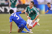 Mexico Javier Hernadez (4) gets fouled by Guatemala Cristian Noriega (3) .  Mexico defeated Guatemala 2-1 in the quaterfinals for the 2011 CONCACAF Gold Cup , at the New Meadowlands Stadium, Saturday June 18, 2011.