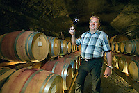 Bolzano, South Tyrol, June 2007. Erich Egger of Camping Moosbauer on 'leads' a tour in the Kettmayr winery in St Paul.  The hills around Bolzano are home to most of the wine production in region of South Tyrol. South Tyrol used to be part of Austria until it became part of Italy after WWI. Photo by Frits Meyst/Adenture4ever.com