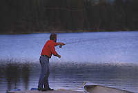 Terry Sheely fly fishing at a lake in northern British Columbia,Canada,model released