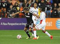 Washington D.C. - April 5, 2014: Nick DeLeon (14) of D.C. United goes against Daigo Kobayashi from the New England Revolution.  D.C. United defeated 2-0 the New England Revolution during a Major League Soccer match for the 2014 season at RFK Stadium.