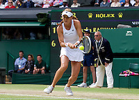 Agnieszka Radwanska..Tennis - Grand Slam - The Championships Wimbledon - AELTC - The All England Club - London - Sat July 7h 2012. .© AMN Images, 30, Cleveland Street, London, W1T 4JD.Tel - +44 20 7907 6387.mfrey@advantagemedianet.com.www.amnimages.photoshelter.com.www.advantagemedianet.com.www.tennishead.net