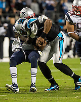 The Carolina Panthers play the New England Patriots at Bank of America Stadium in Charlotte North Carolina on Monday Night Football.  The Panthers defeated the Patriots 24-20.  New England Patriots defensive end Chandler Jones (95) sacks Carolina Panthers quarterback Cam Newton (1)