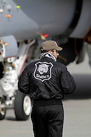 Crew (pilot ?) of a Swiss F-18 Hornet fighter jet with a tiger decorated jacket. Tiger Air show.  Nato Tiger Meet is an annual gathering of squadrons using the tiger as their mascot. While originally mostly a social event it is now a full military exercise. Tiger Meet 2012 was held at the Norwegian air base &Oslash;rlandet.