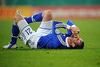 FUSSBALL   DFB POKAL    SAISON 2012/2013    ACHTELFINALE FC Schalke 04 - FSV Mainz 05                          18.12.2012 Christoph Metzelder (FC Schalke 04) enttaeuscht am Boden