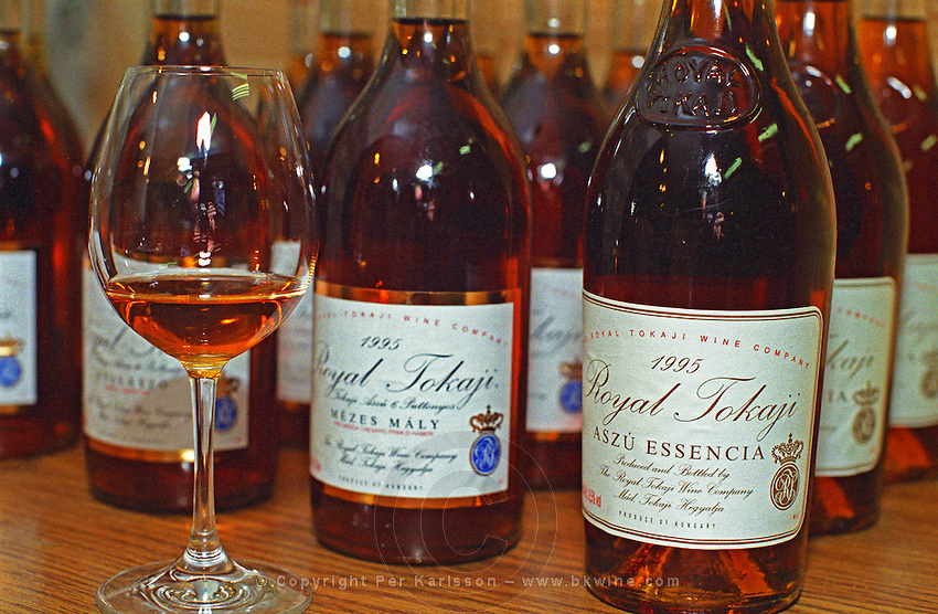 "The Royal Tokaji Wine company in Mad: Bottles of Tokaji Mezes Maly 1995 5 puttonyos, and the rare Aszu Essencia 1995, and a tasting glass. The RTWC in was one of the first Tokaj wineries to be ""revived"" by an injection of foreign capital. It makes wine in a traditional style. Credit Per Karlsson BKWine.com"