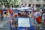 Mayor Pat Patterson drives a golf cart in the 4th of July parade in Oxford, Miss. on Wednesday, July 4, 2012.