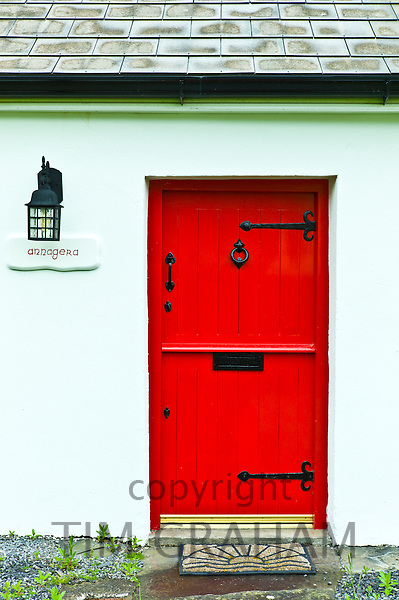 Front door in stable-door style on traditional whitewashed cottage near Quilty, County Clare, West of Ireland