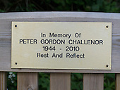 Brass plaque to commemorate someone's life fixed to a public bench, Arnside, Lancashire, UK.