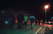Asylum seekers walk towards the Eurotunnel near Sangatte. They make nightly attempts to cross the English Channel to Dover from the Red Cross refugee camp near Calais...Picture taken April 2002 in Sangatte by Justin Jin. Copyright 2002 by Justin Jin.
