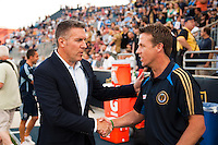 Sporting Kansas City manager Peter Vermes shakes hands with Philadelphia Union interim manager John Hackworth before the match. Sporting Kansas City defeated the Philadelphia Union 2-0 during the semifinals of the 2012 Lamar Hunt US Open Cup at PPL Park in Chester, PA, on July 11, 2012.