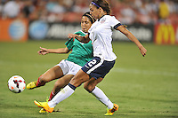 Sydney Leroux (2) of the USWNT goes against Christina Murillo (4) of Mexico. The USWNT defeated Mexico 7-0 during an international friendly, at RFK Stadium, Tuesday September 3, 2013.