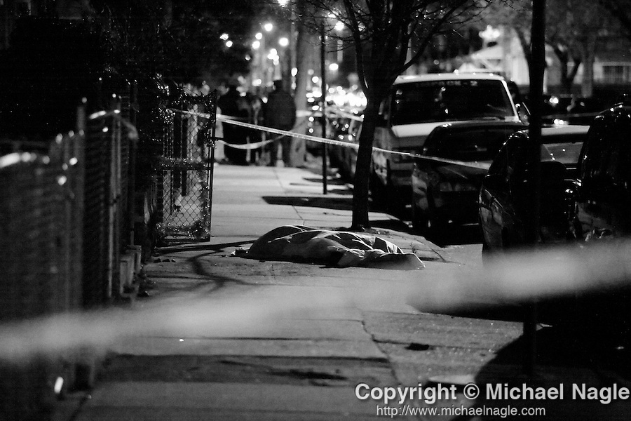 NEW YORK - JANUARY 8:  The NYPD investigate the murder of Max Raymond on East 26th Street near Cortelyou Road on January 8, 2007 in Brooklyn.  Raymond was found dead with two bullets in his chest.  (PHOTOGRAPH BY MICHAEL NAGLE)