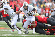 College Park, MD - October 1, 2016: Purdue Boilermakers running back Markell Jones (8) gets tackled by a Maryland Terrapins defender during game between Purdue and Maryland at  Capital One Field at Maryland Stadium in College Park, MD.  (Photo by Elliott Brown/Media Images International)