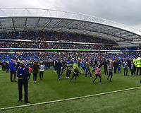Fans invade the pitch<br /> <br /> Brighton 2 - 1 Wigan<br /> <br /> Photographer David Horton/CameraSport<br /> <br /> The EFL Sky Bet Championship - Brighton &amp; Hove Albion v Wigan Athletic - Monday 17th April 2017 - American Express Community Stadium - Brighton<br /> <br /> World Copyright &copy; 2017 CameraSport. All rights reserved. 43 Linden Ave. Countesthorpe. Leicester. England. LE8 5PG - Tel: +44 (0) 116 277 4147 - admin@camerasport.com - www.camerasport.com