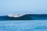 Teahupoo, Tahiti.  An empty wave breaks on the Teahupoo reef. Photo: joliphotos.com