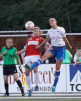 Western New York midfielder McCall Zerboni (7) and Boston Breakers midfielder Leslie Osborne (12) battle for head ball. In a Women's Premier Soccer League Elite (WPSL) match, the Boston Breakers defeated Western New York Flash, 3-2, at Dilboy Stadium on May 26, 2012.