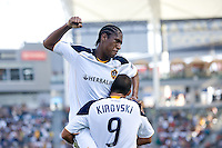 LA Galaxy midfielder Alex Cazumba (88) jumps into the arms of teammate veteran forward Jovan Kirovski (9) after scoring a goal and begin the celebration. The LA Galaxy defeated the Houston Dynamo 4-1 at Home Depot Center stadium in Carson, California on Saturday evening June 5, 2010..
