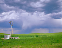 Windmill on prairie with rain falling from distant thunderstorm, south of Agate, Nebraska, AGpix_0299.