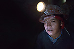 A miner in a mine deep under Cerro Rico in Potosi, Bolivia. The mine produces silver and other metals.