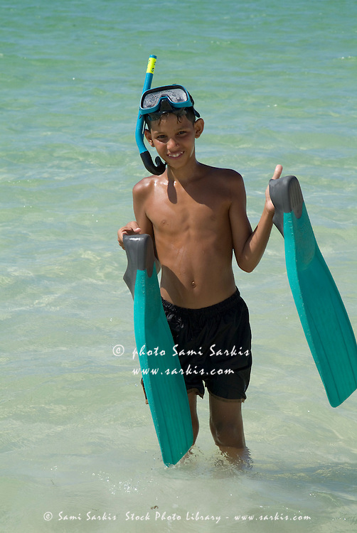 Cuban Boy Holding Swimfins At The Beach Cayo Jutias Cuba Sami Sarkis Stock Photo Library