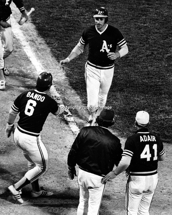 A's Joe Rudi greeted at home by Sal Bando. (1972 photo by Ron Riesterer)