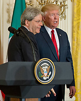 United States President Donald J. Trump, right, and Prime Minister Paolo Gentiloni of Italy, left, depart after conducting a joint press conference in the East Room of the White House in Washington, DC on Thursday, April 20, 2017.<br /> CAP/MPI/RS<br /> &copy;RS/MPI/Capital Pictures