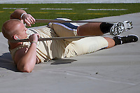 Pitt offensive lineman Jack Lippert stretches before the game. The Pittsburgh Panthers defeated the Rutgers Scarlet Knights 41-21 on October 23, 2010 at Heinz Field, Pittsburgh, Pennsylvania....