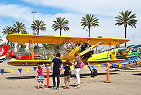 A family admires Museum of Flying's 1947 Boeing Stearman PT 17 during Santa Monica Airport's second annual Open House on Saturday, September 22, 2012.The open house featured self-guided tour of the campus, the largest single open space in the city of Santa Monica, with stops at the Museum of Flying, vintage aircraft displays, an art exhibition at the Santa Monica Art Studios, the Santa Monica Airport Observation Decks, mini -bus tours of the airfield; restaurants, and the Airport Park recreational area.
