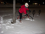 Nancy considers borrowing a bike for a ride at night, just after the blizzard of February 2010 ended in Rehoboth Beach, Delaware, USA.