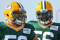GREEN BAY - July 2014: Nick Perry (53) and Julius Peppers (56) of the Green Bay Packers during a training camp practice on July 31st, 2014 at Ray Nitschke Field in Green Bay, Wisconsin.  (Photo Credit: Brad Krause)