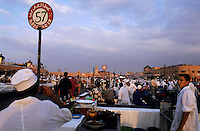 Man selling food at his stall, Djemaa el Fna, Marrakech, Morocco.