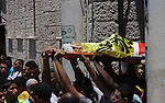 Mourners carry the body of Palestinian youth Yousef Abu Zagha, 20, during his funeral at the Jenin refugee camp, in Jenin, West Bank, 01 July 2014. Media reports citing locals and medics reports state the Israeli forces shot and killed the Palestinian teenager during a military operation in the Jenin refugee camp in the northern West Bank earlier 01 July. Photo by Nedal Eshtayah