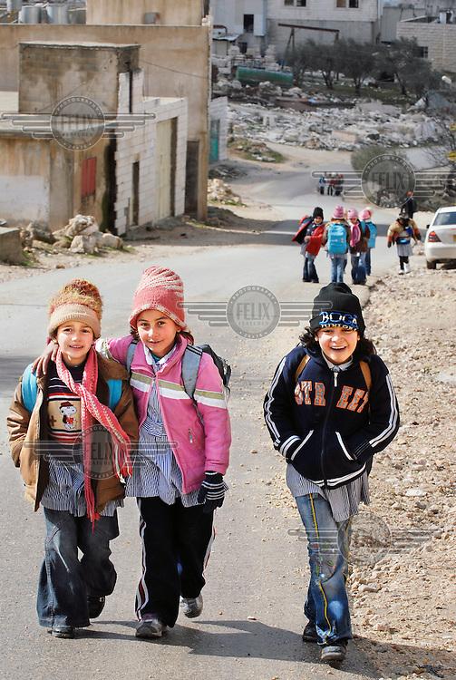 Palestinian children returning home from school.