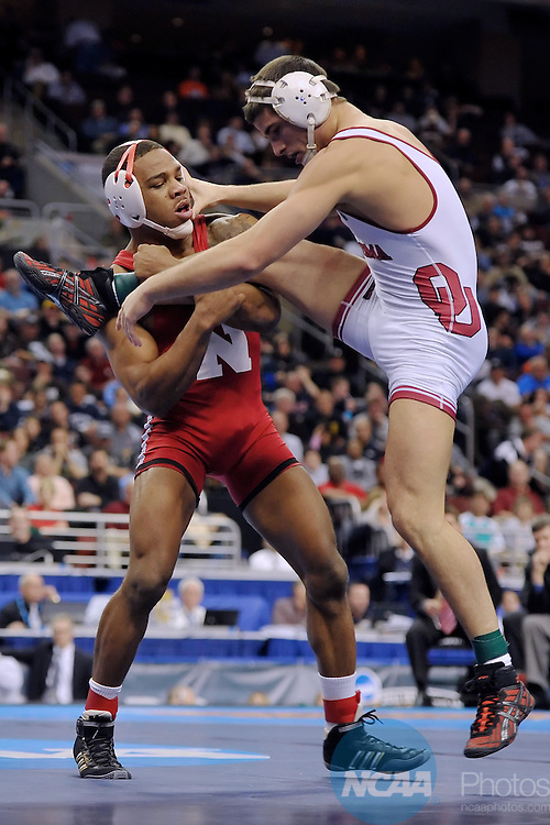 19 MAR 2011: Jordan Burroughs of Nebraska wrestles Tyler Caldwell of the University of Oklahoma during the Division I Men's Wrestling Championship held at the Wells Fargo Center in Philadelphia, PA. Burroughs defeated Caldwell 11-3 to win the 165 pound national title. Drew Hallowell/ NCAA Photos