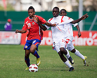Alexander Gonzalez (20) of Panama closes in on Jean Scott (19) of Costa Rica during the quarterfinals of the CONCACAF Men's Under 17 Championship at Catherine Hall Stadium in Montego Bay, Jamaica. Panama defeated Costa Rica, 1-0.