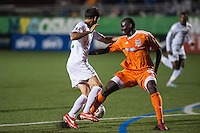 HEMPSTEAD, NY – OCTOBER 12: Alessandro Noselli of the New York Cosmos is fouled in the penalty box by Henry Kalungi of the Carolina RailHawks during an NASL match on October 12, 2013 at  Shuart Stadium in Hempstead, New York.