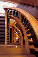 The winding staircase at the Chicago Cultural Center which opened in 1897. It is a Chicago Landmark building that houses the city's official reception venue where the Mayor of Chicago has welcomed Presidents and royalty, diplomats and community leaders. It is located in the Loop, across Michigan Avenue from Millennium Park. Originally the central library building, it was converted to an arts and culture center at the instigation of Commissioner of Cultural Affairs Lois Weisberg. The city's central library is now at home across the Loop in the spacious, post-modernist Harold Washington Library Center opened in 1991...As the nation's first free municipal cultural center, the Chicago Cultural Center is one of the city's most popular attractions and is considered one of the most comprehensive arts showcases in the United States. Each year, the Chicago Cultural Center features more than 1,000 programs and exhibitions covering a wide range of the performing, visual and literary arts