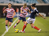 Tobin Heath (17) of the USWNT fights for the ball with Jennifer Beattie (10) of Scotland during the game at EverBank Field in Jacksonville, Florida.  The USWNT defeated Scotland, 4-1.