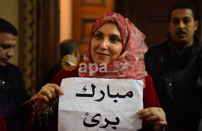 Egyptian supporters of ousted president Hosni Mubarak react inside the courtroom in Cairo on January 9, 2016, after top appeals court upheld upheld a three-year prison sentence for Mubarak and his two sons for corruption. Photo by Amr Sayed