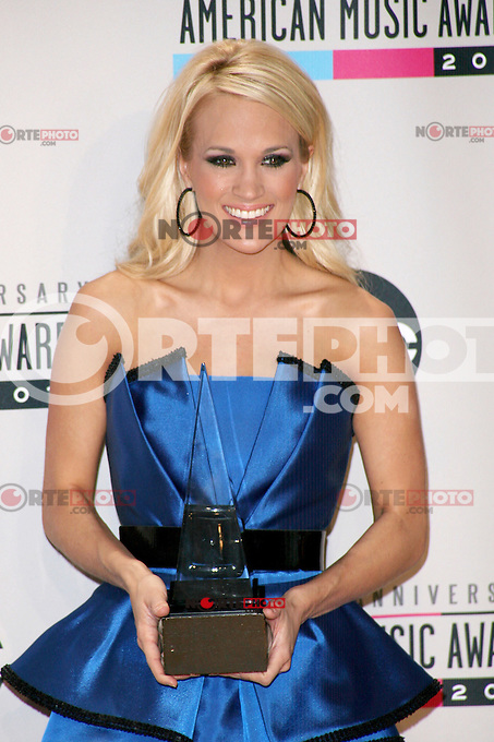 LOS ANGELES, CA - NOVEMBER 18: Carrie Underwood in the press room at the 40th American Music Awards held at Nokia Theatre L.A. Live on November 18, 2012 in Los Angeles, California. Credit: mpi20/MediaPunch Inc. /NORTEPHOTO